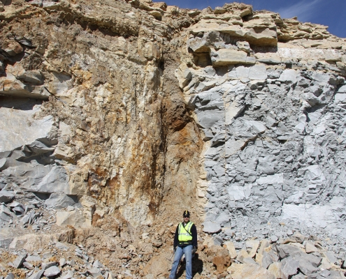Ryan Clark at work in a quarry where karst landscapes are typically underlain by shallow limestone, and surface drainage is connected to subterranean cavern systems via sinkholes and vertical openings in the rock.