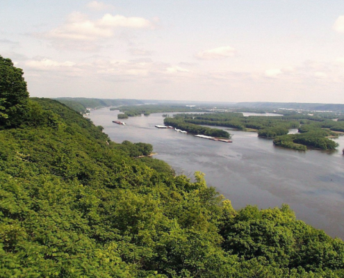 View of the green, leafy Mississippi River Valley near Pikes Peak in Iowa's Clayton County.