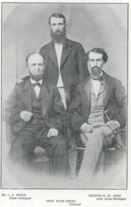 A black and white photo of three men with beards