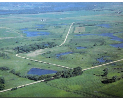 Aerial view of Iowa landscape dotted with small lakes and ponds.