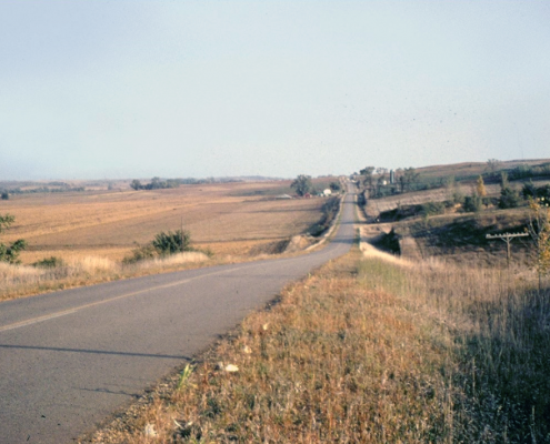 A two-lane highway stretches out like a ribbon across Northwest Iowa's till plains
