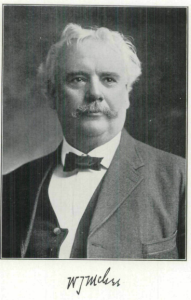 Vintage black and white photo of a white-haired man with a moustache