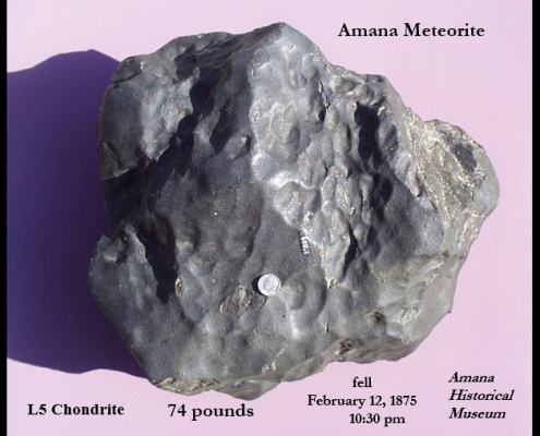 A chunk of rock labeled the Amana Meteorite on a lavender background