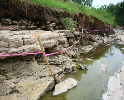 Rocky fossiliferous formations exposed by floodwater