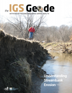 A man looks down at an eroded streambank on the cover of The IGS Geode