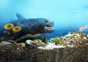 A museum diorama of the Devonian Gorge featuring a large armored carnivorous fish