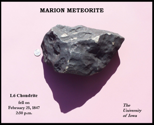 A photo of the Marion meteorite against a pink background