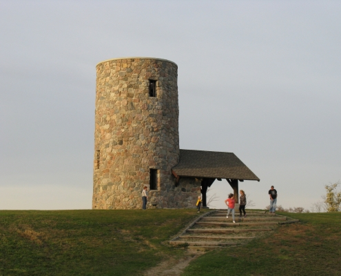A stone tower at the top of a hill