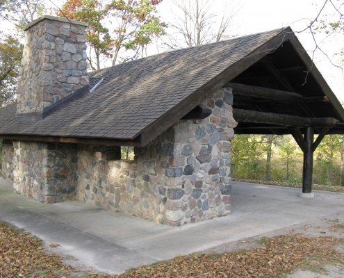 A rustic-looking stone picnic shelter