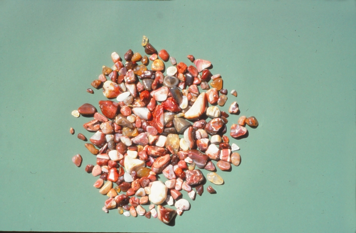 A scattering of small, shiny agates in many colors