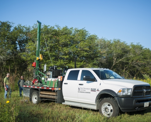 Pickup truck with drill rig attached